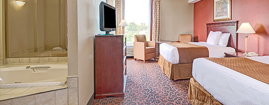Ramada by Wyndham Niagara Falls Fallsview - 2 Queen Bed Whirlpool Suite with Private Balcony - Dining Voucher Included